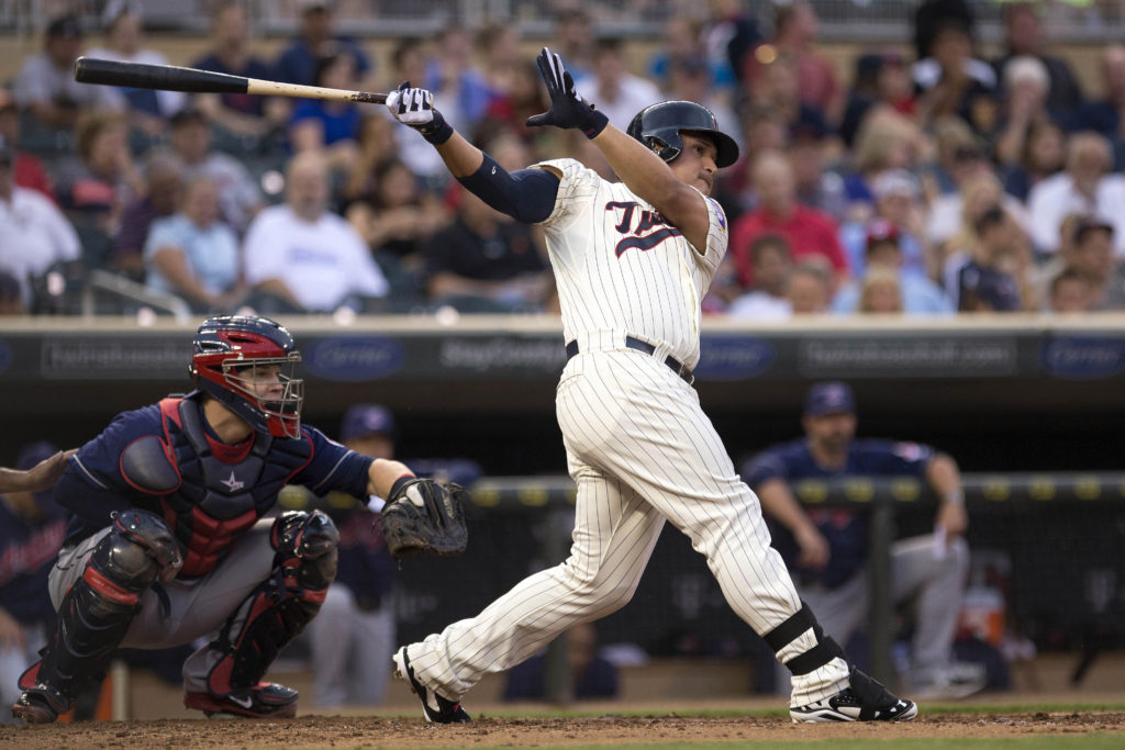 Aug 20, 2014; Minneapolis, MN, USA; Minnesota Twins right fielder Oswaldo Arcia (31) hits a single in the second inning against the Cleveland Indians at Target Field. Mandatory Credit: Jesse Johnson-USA TODAY Sports