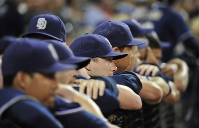 The San Diego Padres look out from the dugout during the ninth inning of a baseball game against the Colorado Rockies Friday, Sept. 3, 2010 in San Diego. The Padres lost 4-3. (AP Photo/Denis Poroy)